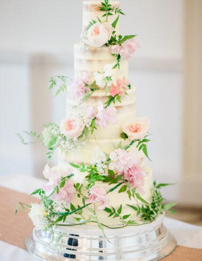 Cheryl 5 tier semi naked wedding cake