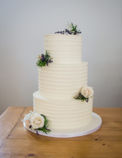 Clarissa buttercream wedding cake simple ivory rustic finish with fresh flowers Staverton Northamptonshire