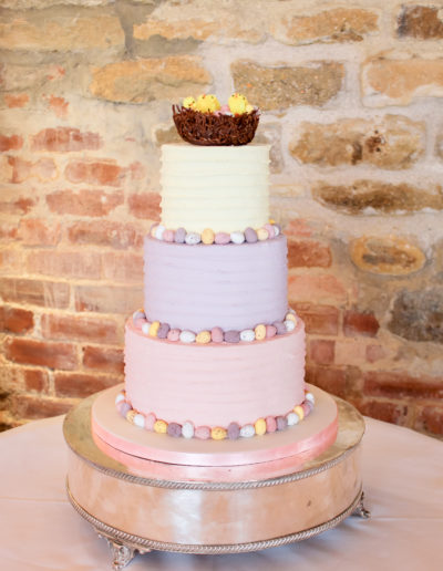 Elis buttercream wedding cake pastel butterfream Easter theme Cadbury mini eggs Dodford Manor Dodford Northamptonshire