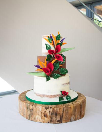 Emily semi naked wedding cake with bird of paradise sugar flowers Blackwell Grange Warwickshire