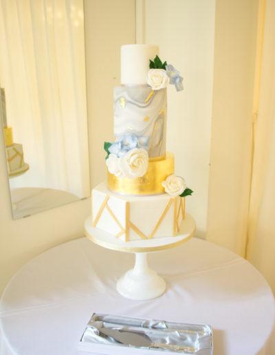 Sarah wedding cake hexagonal geometric grey gold and dusty blue Warwick House Southam 2